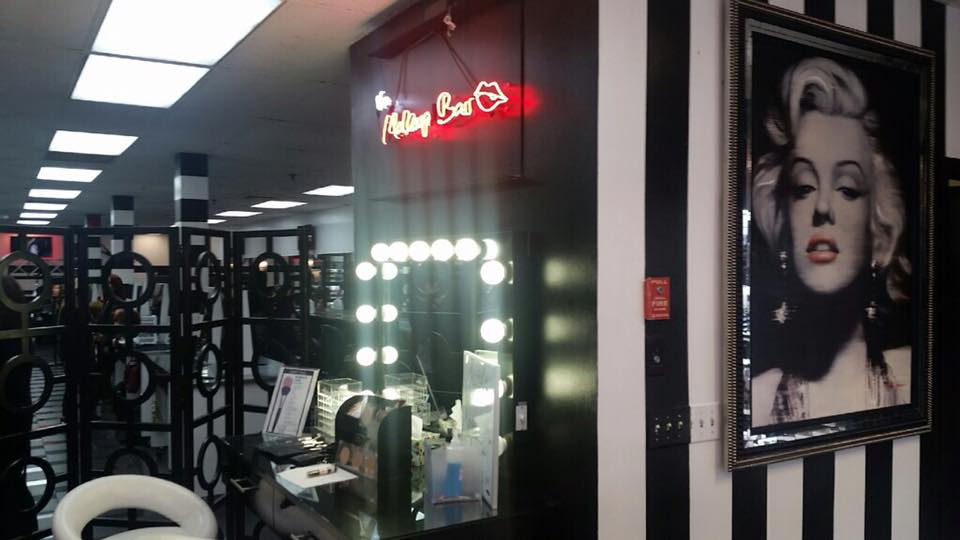 The makeup bar with a picture of Marilyn Monroe next to it.