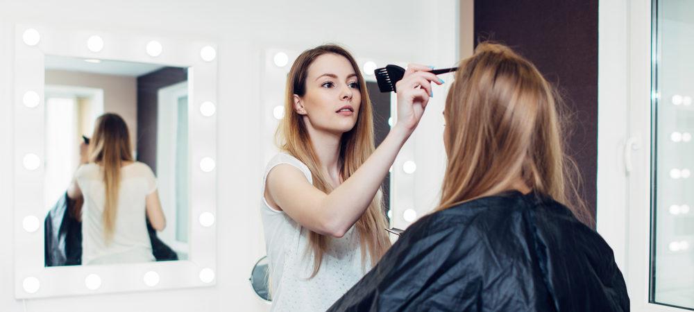 hair stylist doing a clients hair